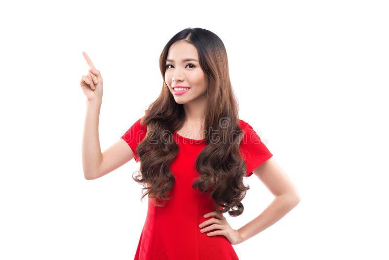 Uma mulher está apresentando algo em Chrtstmas, asiático imagens de stock royalty free