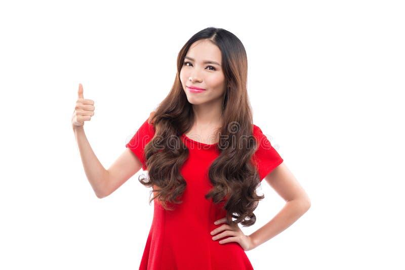 Uma mulher está apresentando algo em Chrtstmas, asiático fotos de stock royalty free