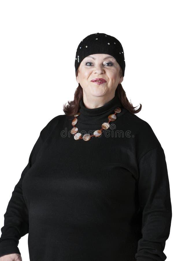 Uma mulher gorda em um fato de esporte fotos de stock