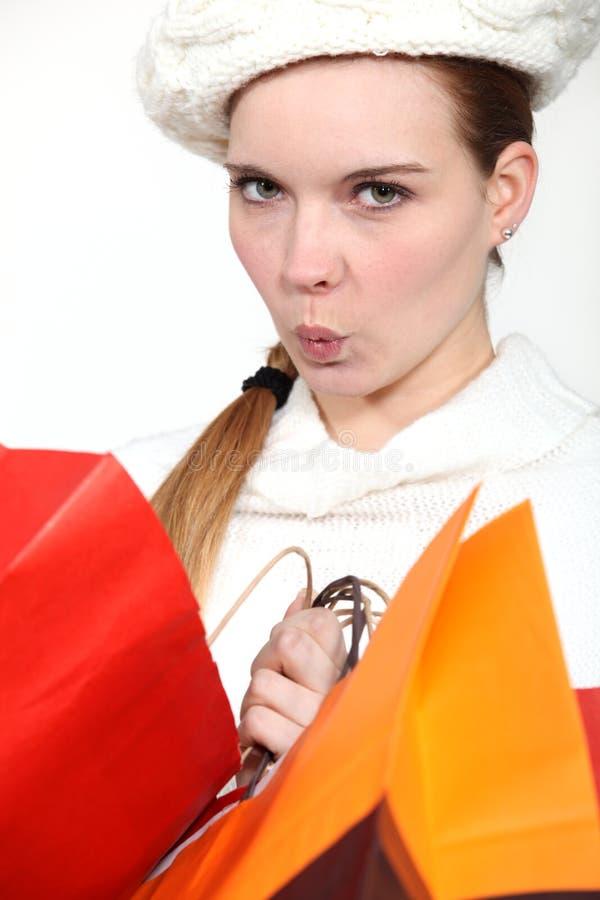Uma mulher na agitação da compra. fotos de stock royalty free