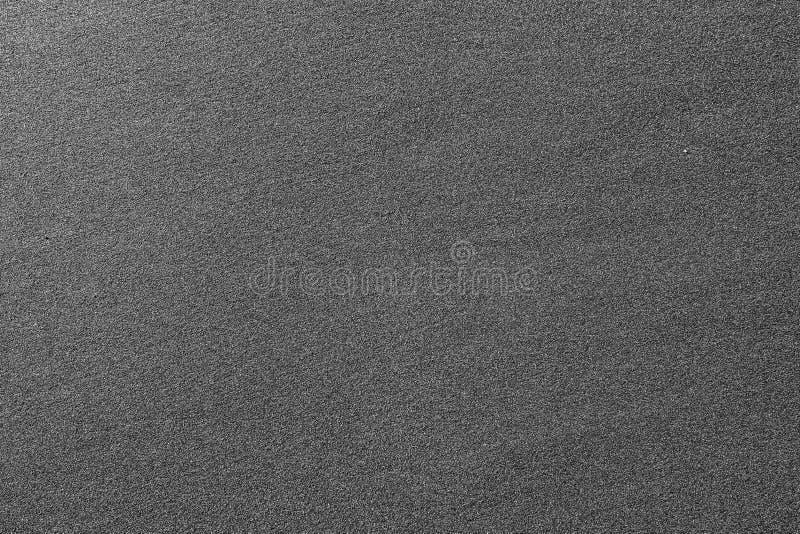 Uma opinião do close up da areia na frente marítima, praia preta da areia - o Mar Negro, Geórgia, fundo fotografia de stock royalty free