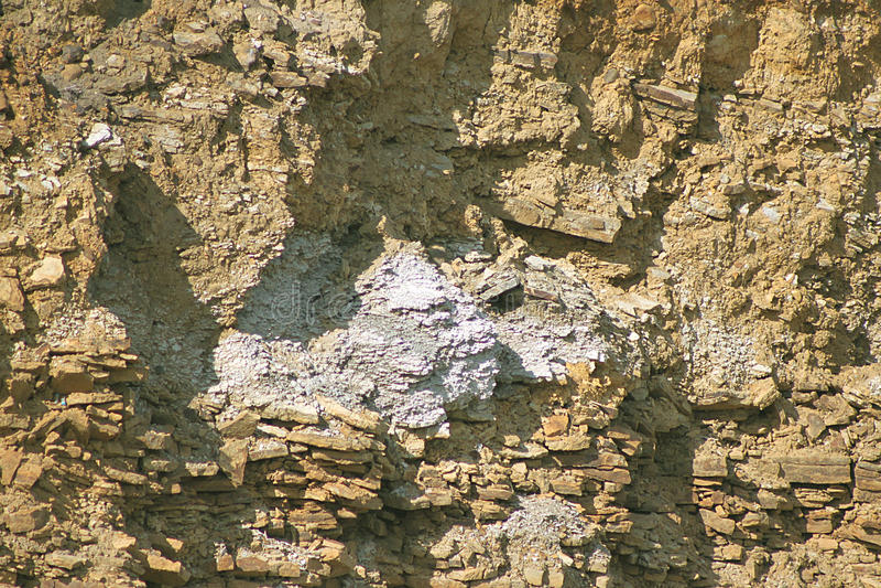 Uma parede de pedra com sombras para o fundo, projeto foto de stock royalty free