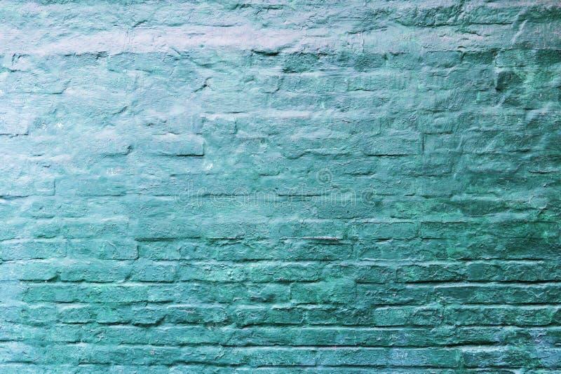 Uma parede de tijolo azul velha e tempo-gasta fotografia de stock royalty free