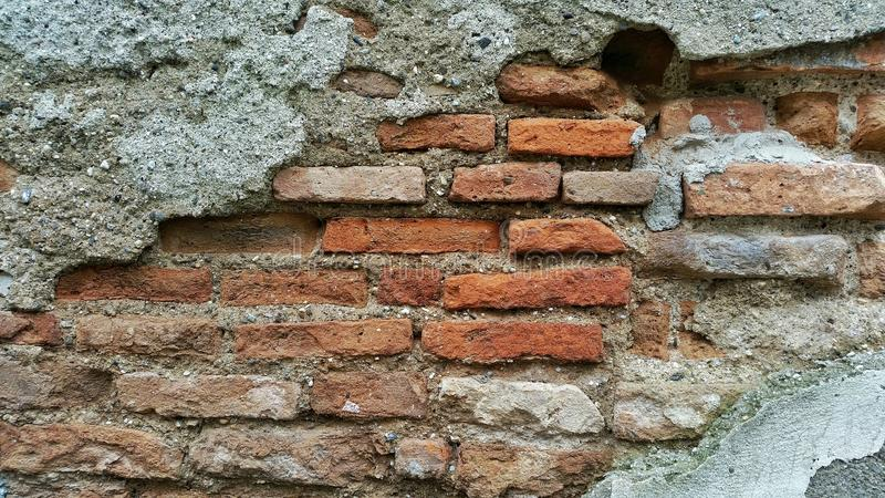 Uma parede de tijolos velha foto de stock