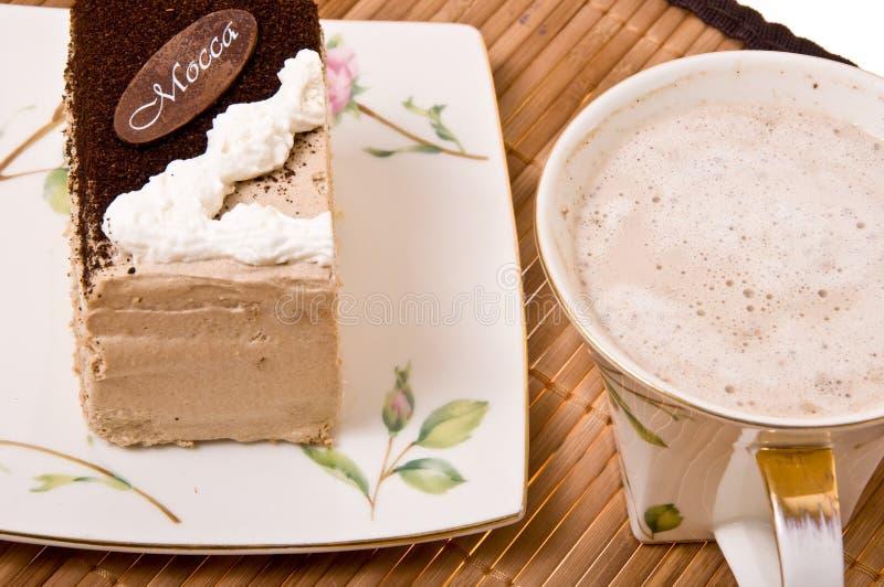 Uma parte de bolo e de café. imagem de stock royalty free