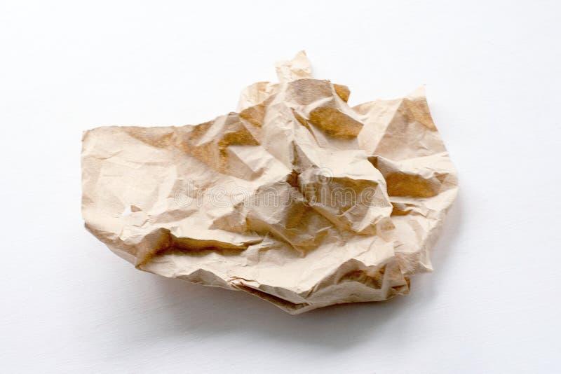 Uma parte de papel amarrotado em um fundo claro imagem de stock royalty free