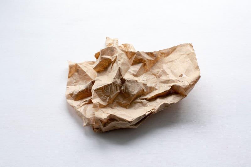 Uma parte de papel amarrotado em um fundo claro foto de stock royalty free