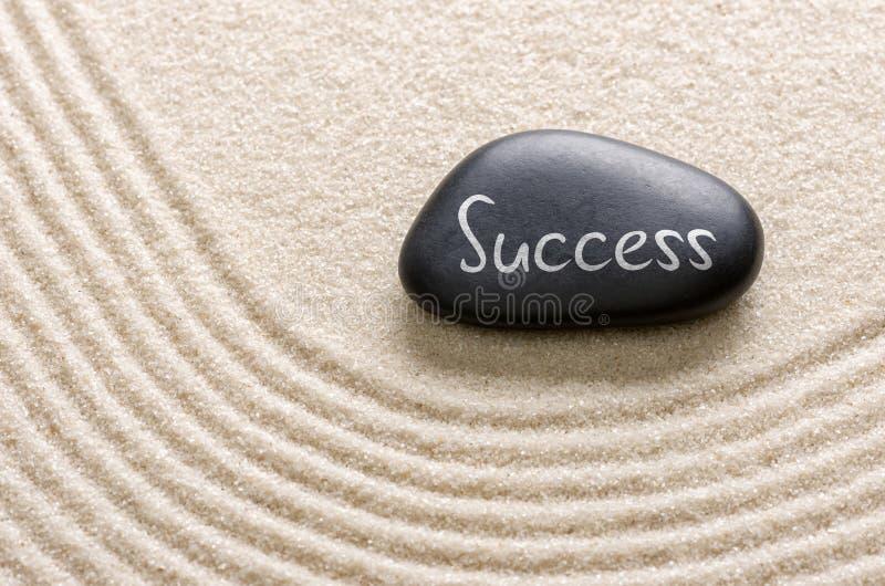 Uma pedra com o sucesso da inscrição imagem de stock