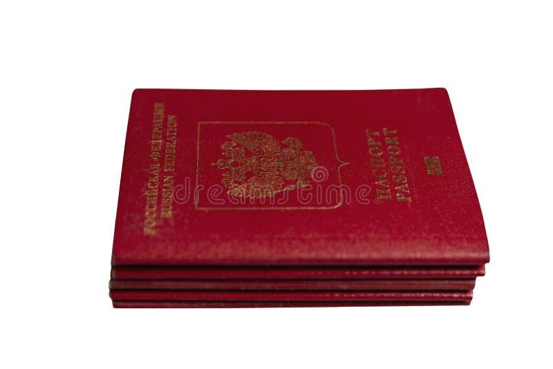 Uma pilha de passaportes do russo, isolada no fundo branco fotos de stock