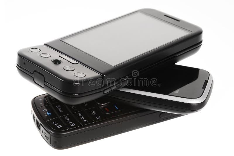 Uma pilha de telefones de pilha foto de stock royalty free