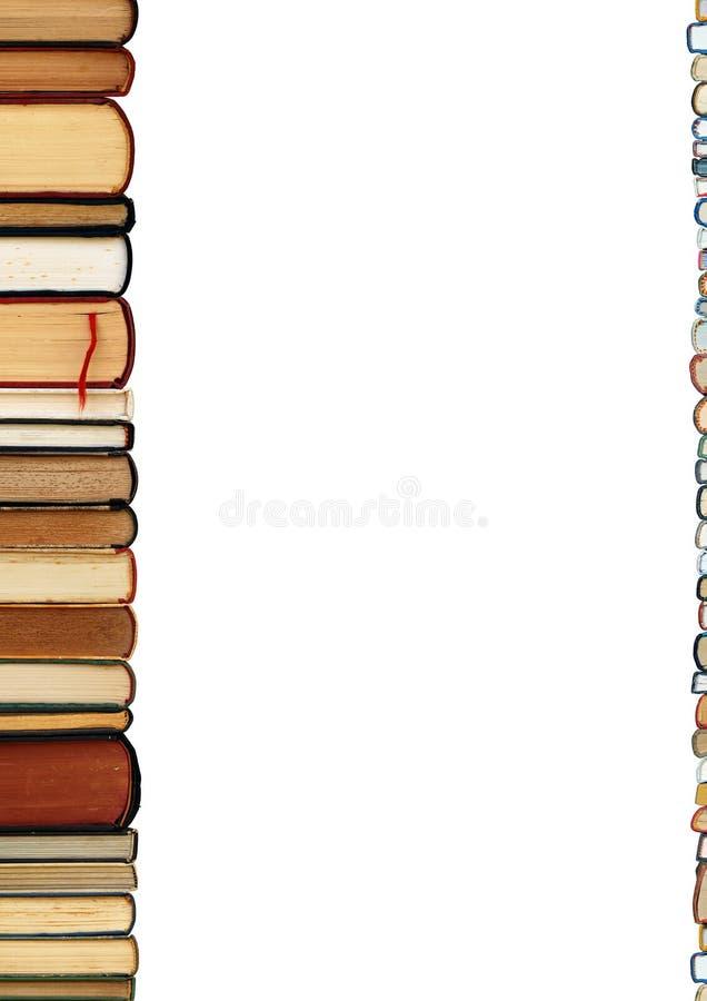 Uma pilha dos livros isolados no fundo branco imagens de stock royalty free
