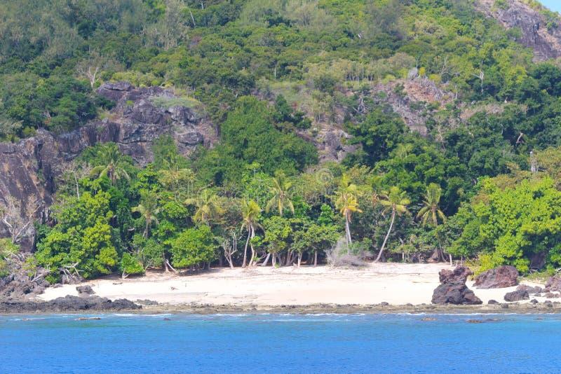 Uma praia nas ilhas sagrados, ilhas de Mamanuca, Fiji foto de stock