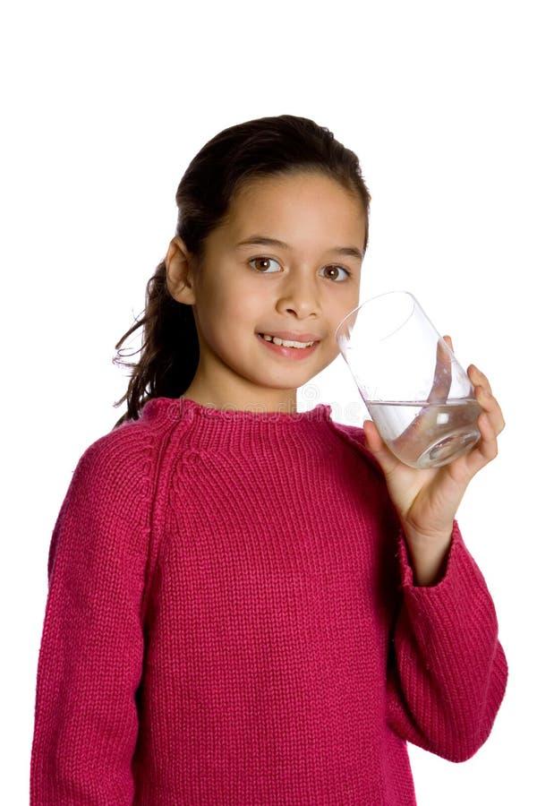 Uma rapariga com um vidro da água. imagens de stock royalty free