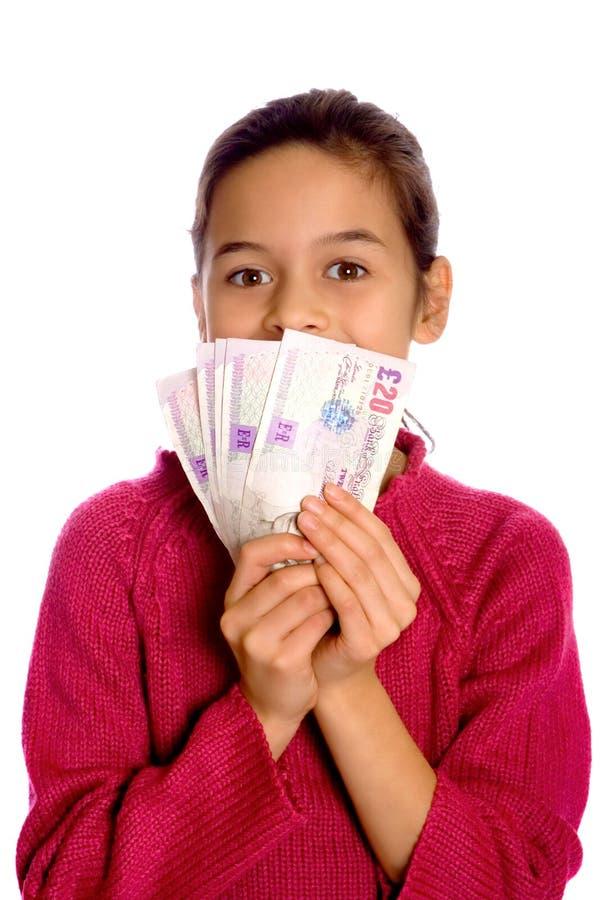 Uma rapariga que mostra fora um grupo da moeda fotografia de stock royalty free
