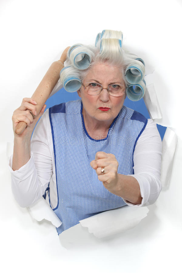 Uma senhora idosa menacing fotos de stock royalty free