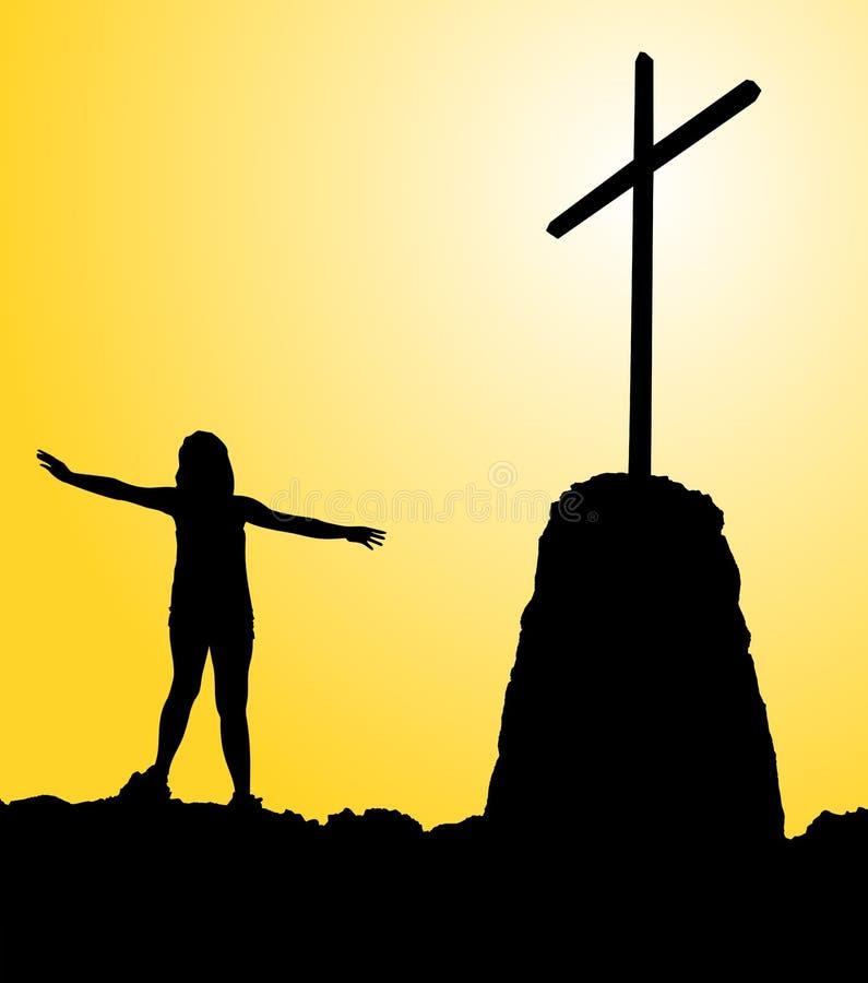 Uma silhueta de uma mulher reza na frente da cruz para o salva??o de sua alma fotos de stock