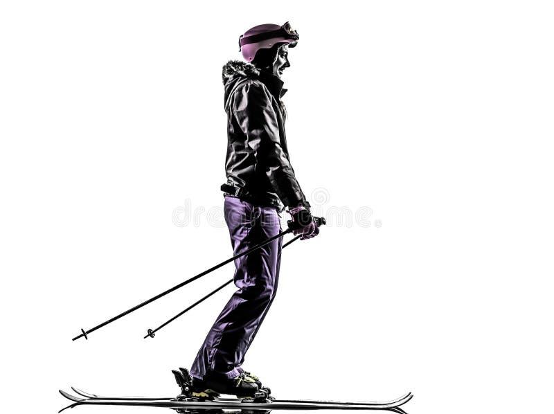Uma silhueta do esqui do esquiador da mulher fotografia de stock