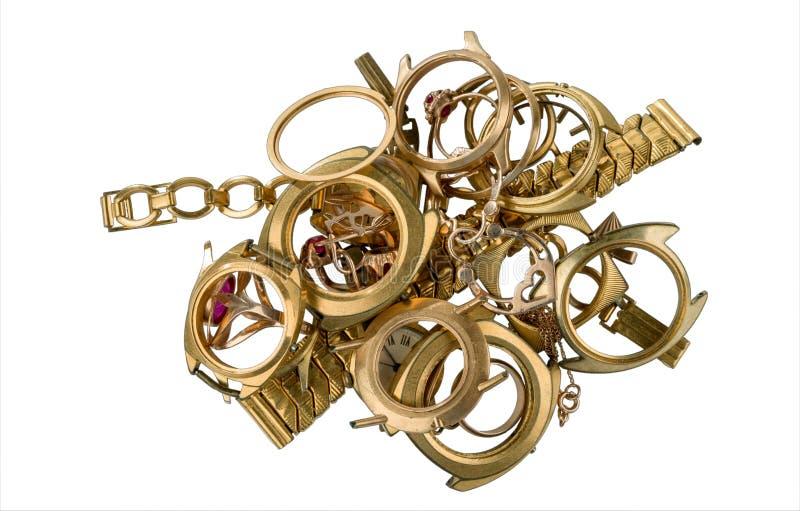Uma sucata do ouro isolada em um fundo branco imagens de stock royalty free