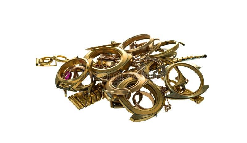 Uma sucata do ouro Joia velha e quebrada, relógios do ouro e folheado a ouro isolados em um branco imagens de stock