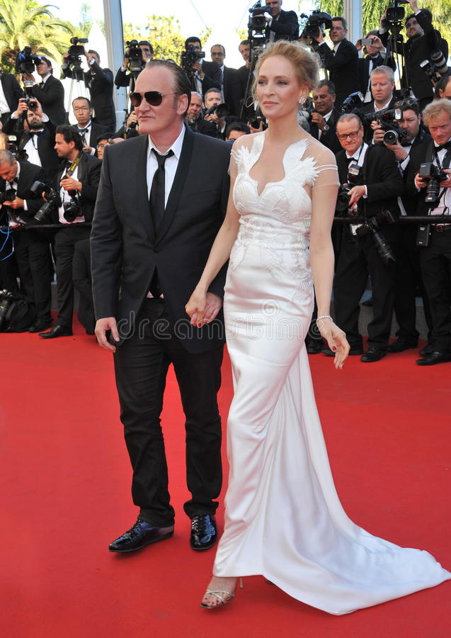 Uma Thurman & Quentin Tarantino. CANNES, FRANCE - MAY 24, 2014: Uma Thurman & Quentin Tarantino at the gala awards ceremony at the 67th Festival de Cannes royalty free stock photo