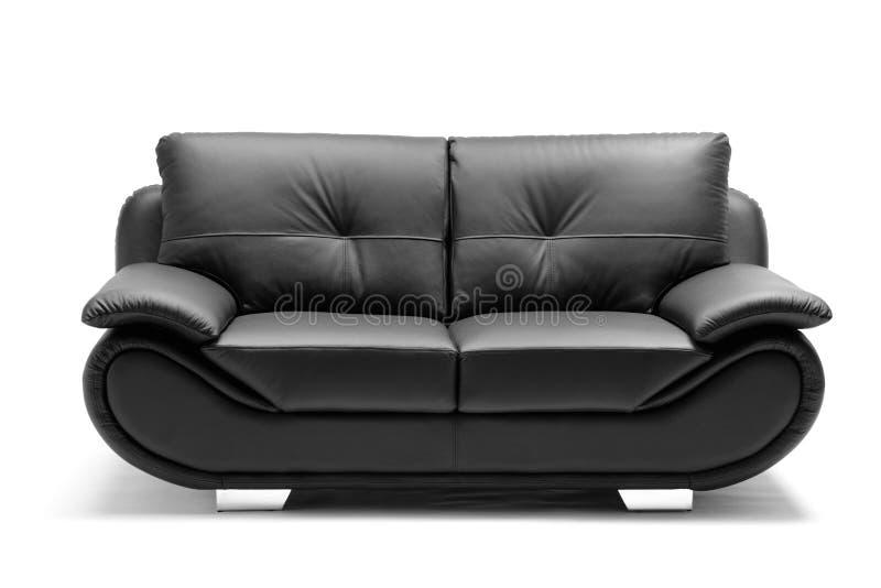 Uma vista de um sofá de couro moderno imagens de stock