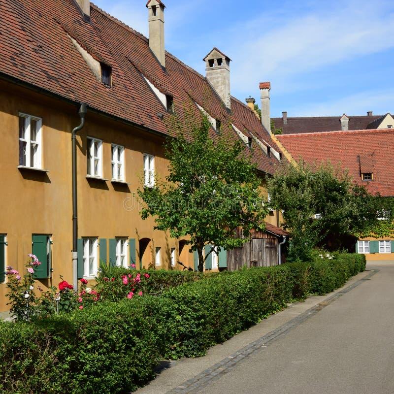Uma vista do FUGGEREI em Augsburg, Alemanha foto de stock