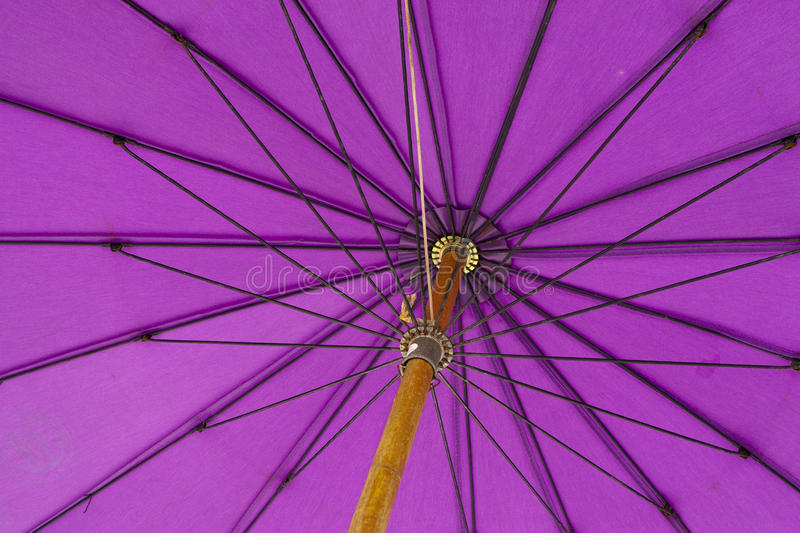 Umbrella. Close-up on the underneath of a purple umbrella with wooden handle stock photos