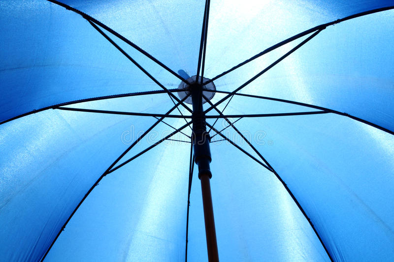 Umbrella. Close up bottom view of a blue umbrella stock photography