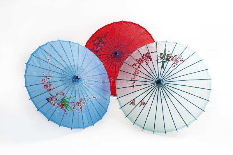 Umbrella. Three asia different colored umbrellas stock photo