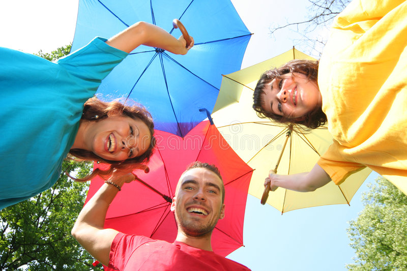 Umbrella. Funny colorful friends with umbrellas royalty free stock images