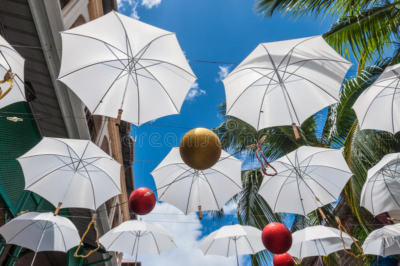 Umbrella above the head in Port Louis, Mauritius royalty free stock images