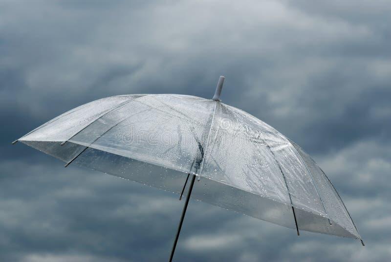 Umbrella against cloudy sky stock photography