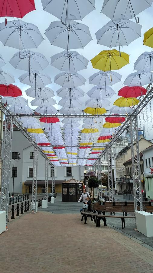 Umbrella alley Komsomolskaya street Minsk Belarus 05.2019. 052019, arhitecture, architecture, old, day, culture, landmark, house, people, red, road, shop stock photography