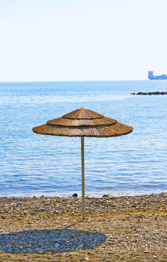 Umbrella on beach stock image