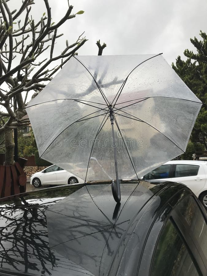 Umbrella on a car royalty free stock images