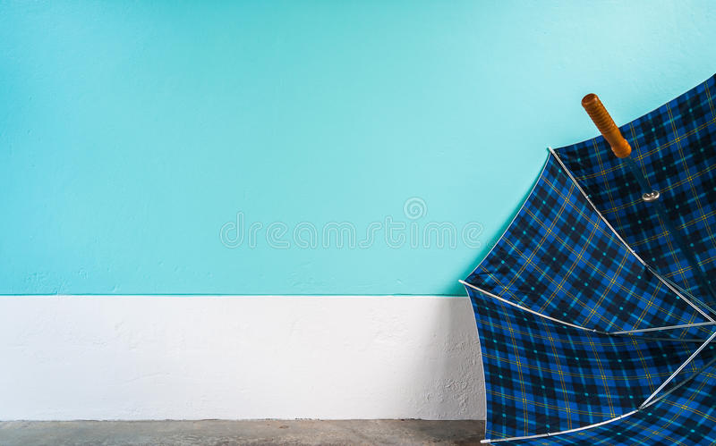 Umbrella on cement floor with pastel wall background stock photo