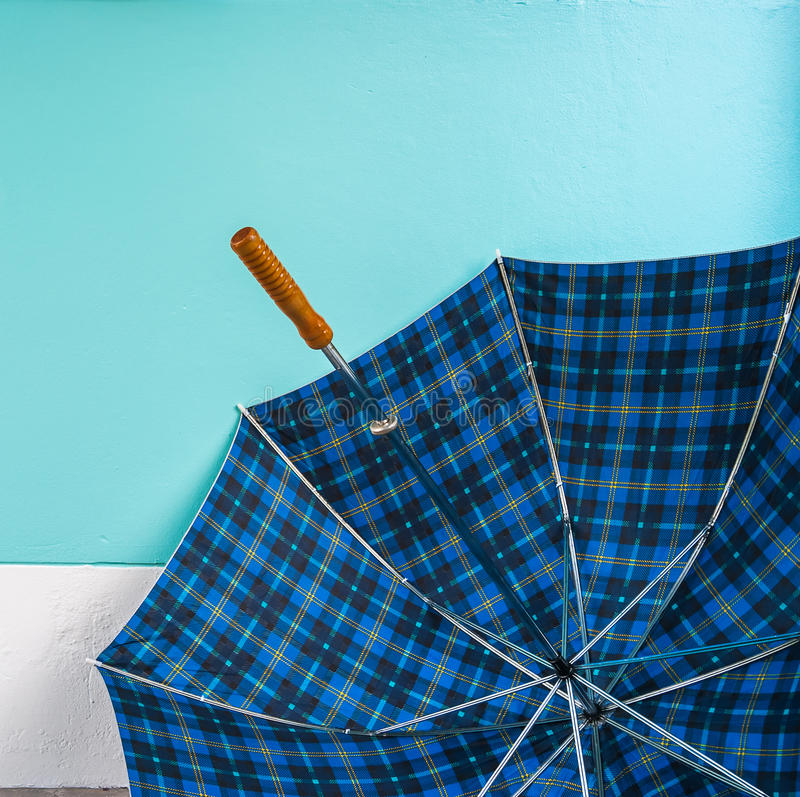 Umbrella on cement floor with pastel wall background royalty free stock image