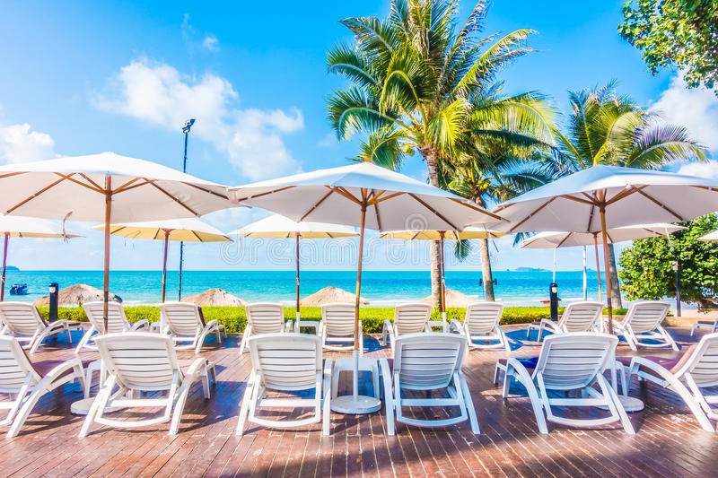 Umbrella and chair. Beautiful luxury umbrella and chair around outdoor swimming pool in hotel resort - Holiday Vacation concept for background royalty free stock image