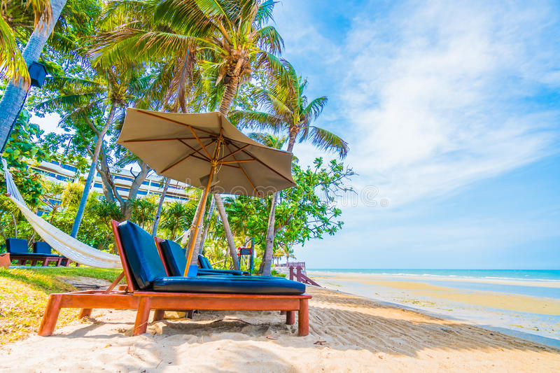 Umbrella and chair royalty free stock images