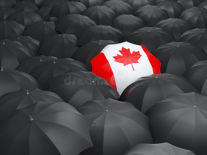 Umbrella with flag of canada royalty free stock photos