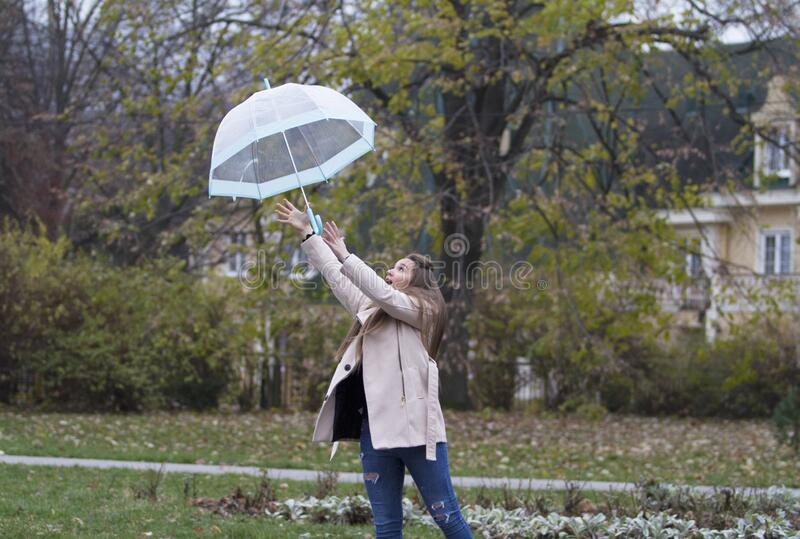 The umbrella flew because of the strong wind. stock photo