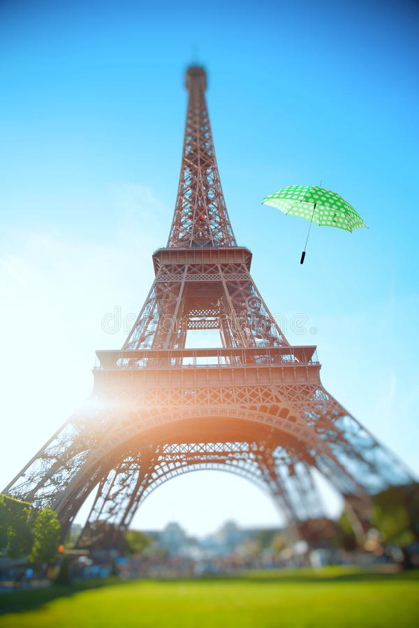 umbrella flying through the air against the backdrop of the Eiffel Tower. Summer trip to France royalty free stock image