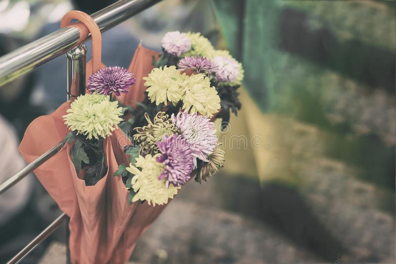 Umbrella with fresh flowers. Autumn scene, picturesque colors of nature, vintage background, seasonal mood concept stock images