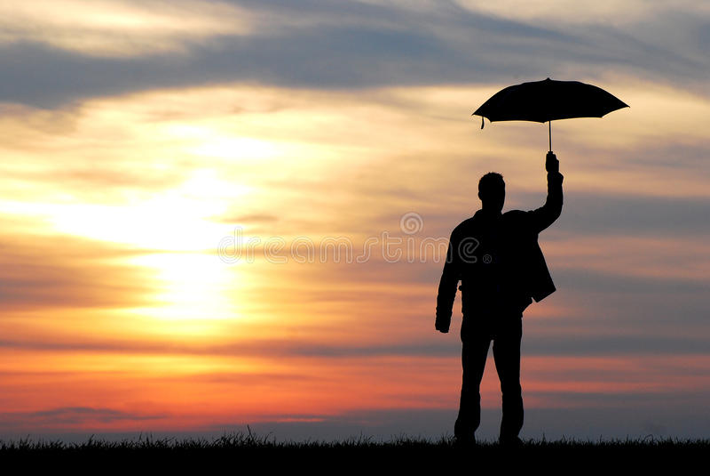 Umbrella man. Silhouette of a man with umbrella stock image