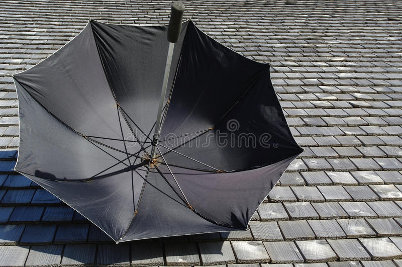 Umbrella and moderny roof. royalty free stock photo
