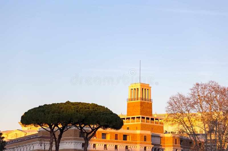 umbrella pine trees in front of castle in mediterranean architecture in rome italy with blue sky at sunset stock images