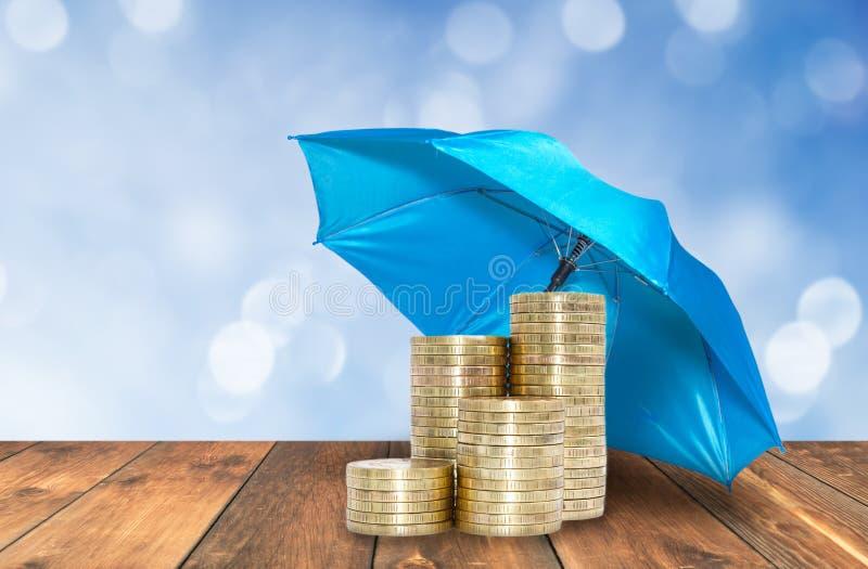 Umbrella protection coins savings stock photography