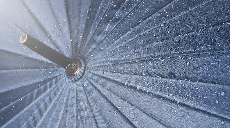 Umbrella in the rain drops.  stock photo