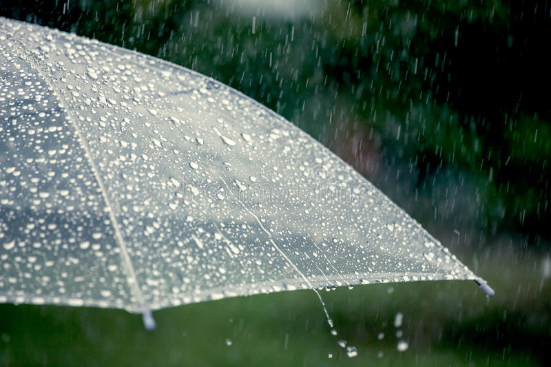 Umbrella in the rain. In vintage color tone royalty free stock image