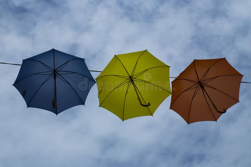 Umbrella in red, yellow and blue royalty free stock photography